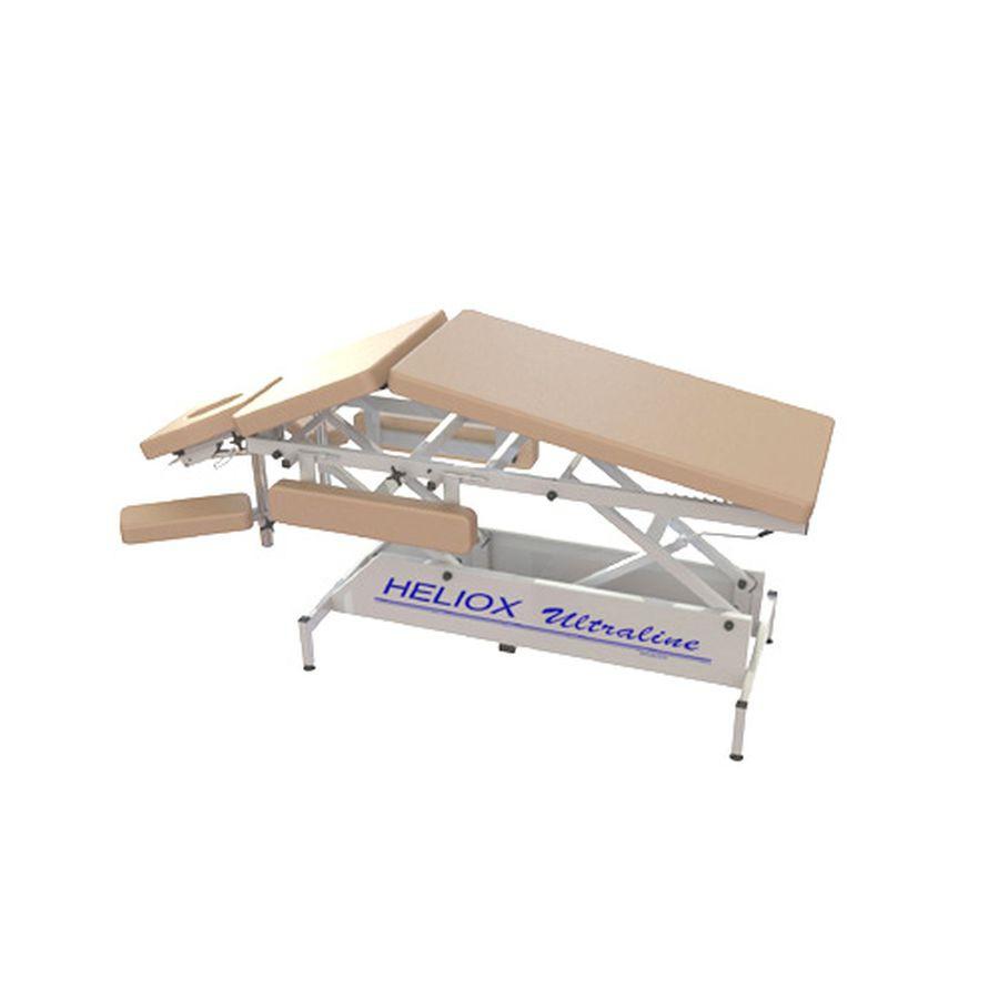 Стационарный массажный стол Heliox FM3Массажный стол оснащен: Механическим приводом, позволяющим устанавливать высоту стола, без нагрузки. Регулировкой секций ложа в положение &amp;laquo;домиком&amp;raquo;. Изменяемым углом наклона ножной секции ложа. Бесступенчато регулируемыми передними подлокотниками. Боковыми поддержками для рук, с механизмом фиксации. Регулировкой угла наклона лицевой части. Дополнительным положением подголовника для массажа воротниковой зоны шеи. Регулирующимися ножками для компенсации неровностей пола.<br>
