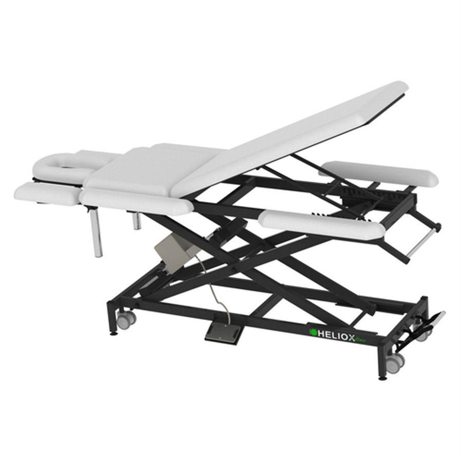Массажный стол Heliox X103P (на Х-раме с электроприводом)Массажный стол, 9-ти секционный на Х-раме, благодаря Х-образной конструкции рамы, стол обладает превосходной устойчивостью, надежностью, выдерживает нагрузку до 350кг, а также уменьшенным весом. Стандартно оснащается колесной базой, с центральным подъемным механизмом, держателем для полотенец и держателем для педали.<br>