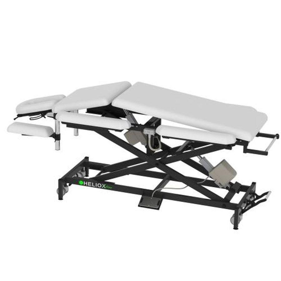 Массажный стол Heliox X203P (на Х-раме с двумя электроприводами)Массажный стол, 9-ти секционный на Х-раме, благодаря Х-образной конструкции рамы, стол обладает превосходной устойчивостью, надежностью, выдерживает нагрузку до 350кг, а также уменьшенным весом. Благодаря дополнительному электроприводу, установка ложа в положение излом(домиком) не потребует никаких усилий. Стандартно оснащается колесной базой, с центральным подъемным механизмом, держателем для полотенец и держателем для педали.<br>