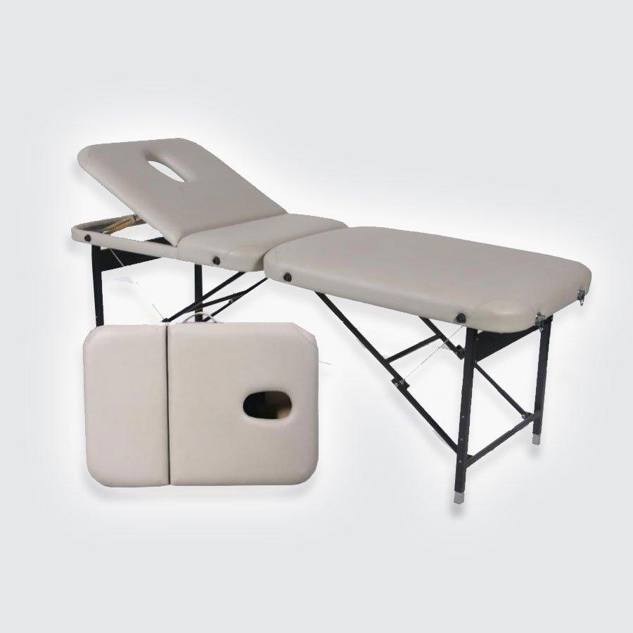 Cкладной массажный стол Med-Mos JFST02Массажный стол легко и быстро трансформируется в чемодан. Основа - многослойная легкая фанера. Рама - сталь. Поверхность - высокачественный винил. Наполнение - плотный пенополиуретан толщиной 5 см. Цвет - бежевый, синий. Регулировка по высоте. В комплекте: съемный, регулируемый подголовник, подставка для рук.<br>