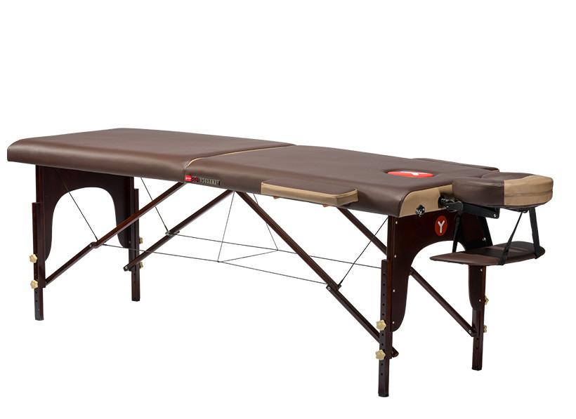 Складной массажный стол Yamaguchi Nagano 1998NAGANO 1998 &amp;mdash; изящный массажный стол с усовершенствованными подлокотниками, обеспечивающими дополнительный комфорт. Ножки и каркас этой модели, выполненные из бука, не только усиливают прочность всей конструкции, но и подчеркивают ее изысканность, а гармоничное сочетание шоколадного и карамельного цвета завершают безупречный образ премиальной модели.<br>